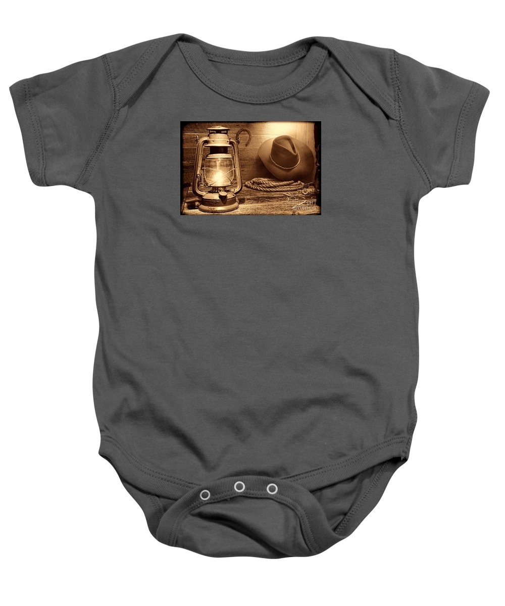 Western Baby Onesie featuring the photograph Kerosene Lantern by American West Legend By Olivier Le Queinec