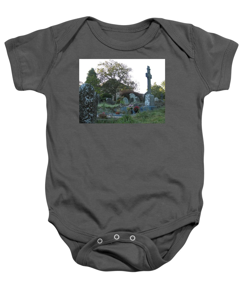 Graveyard Baby Onesie featuring the photograph Kilmokea Graveyard by Kelly Mezzapelle