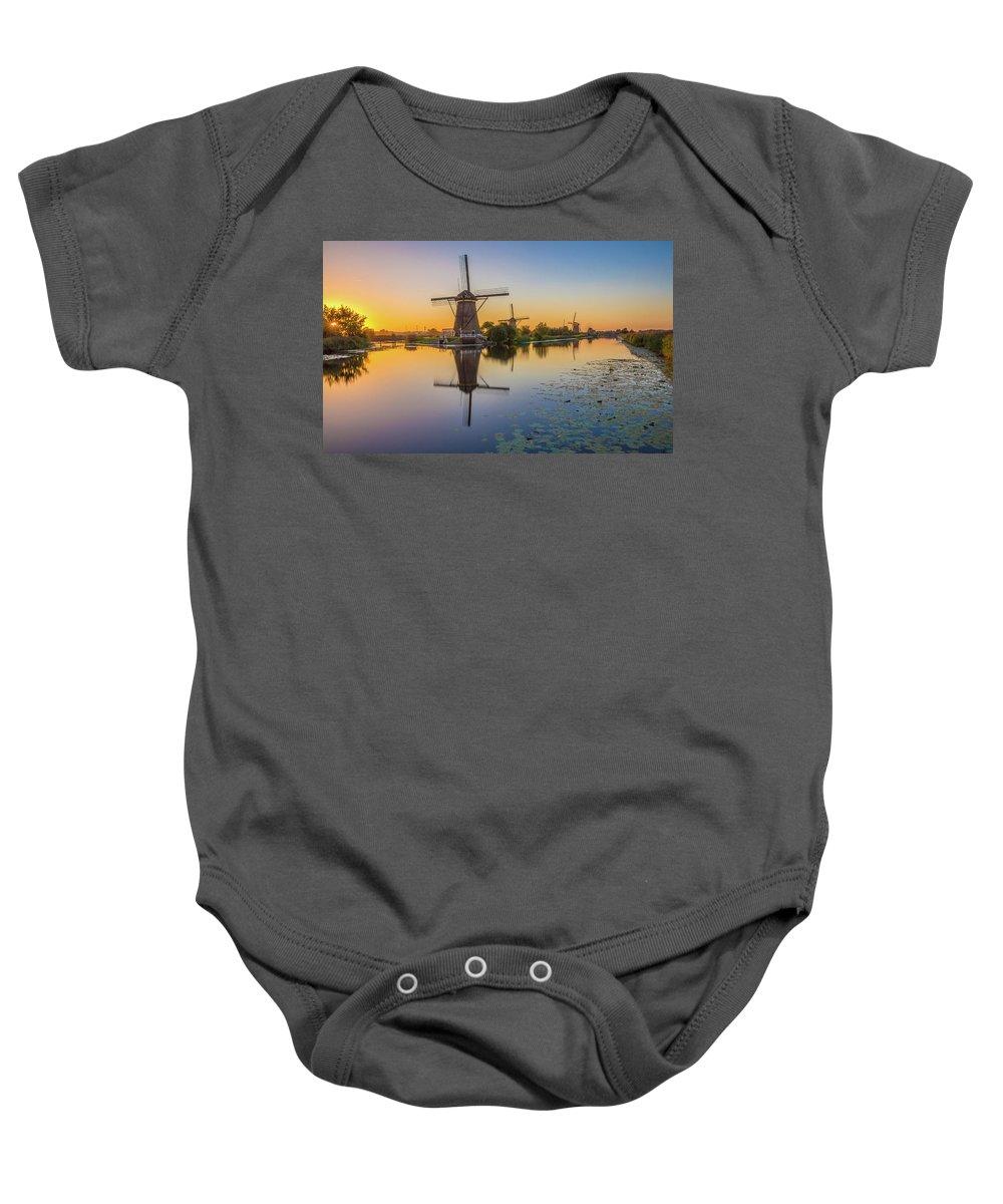 Kinderijk Windmills Baby Onesie featuring the photograph Kinderdijk At Sunset by Christian Tuk