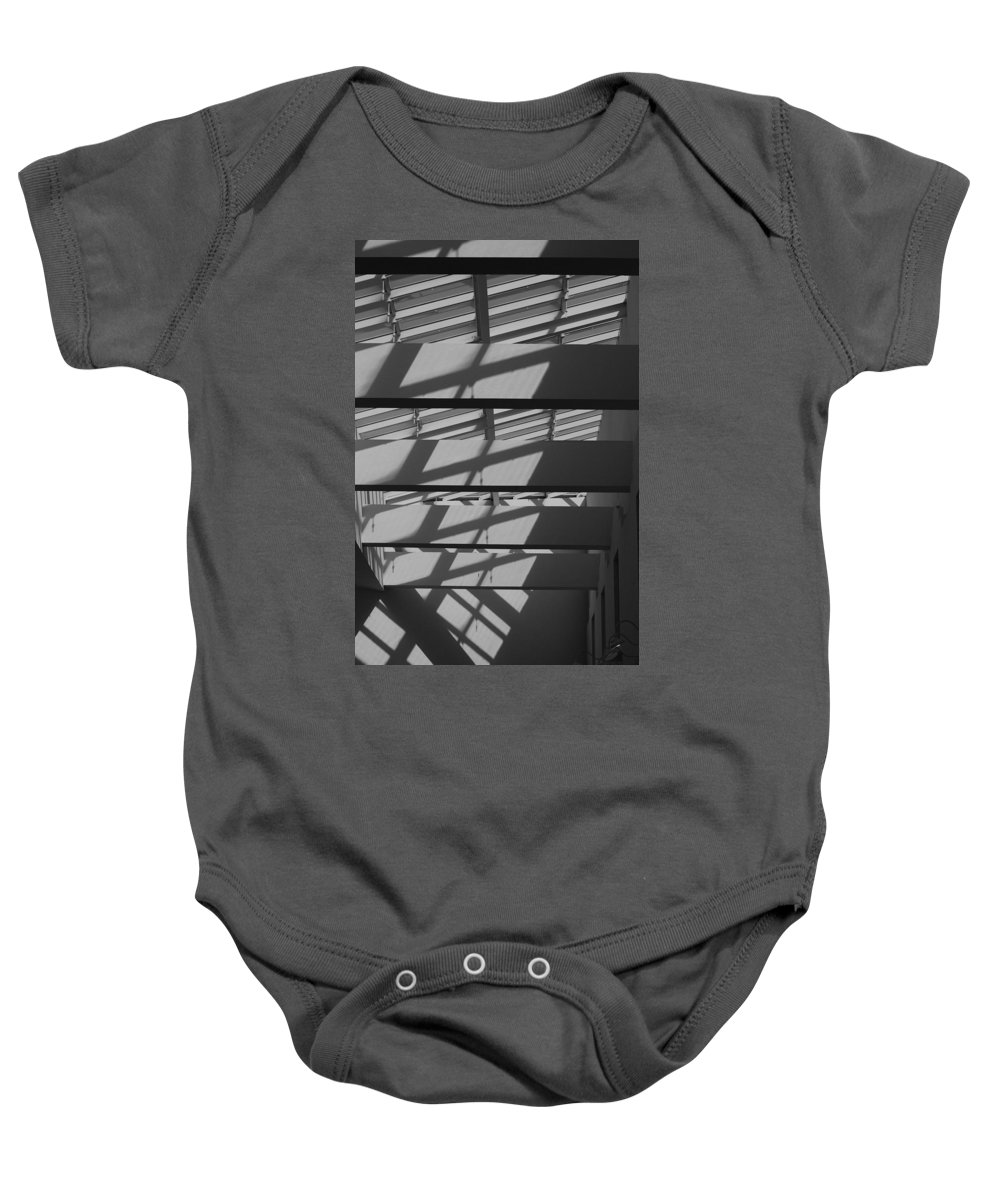 Black And White Baby Onesie featuring the photograph Ladders In The Sky by Rob Hans