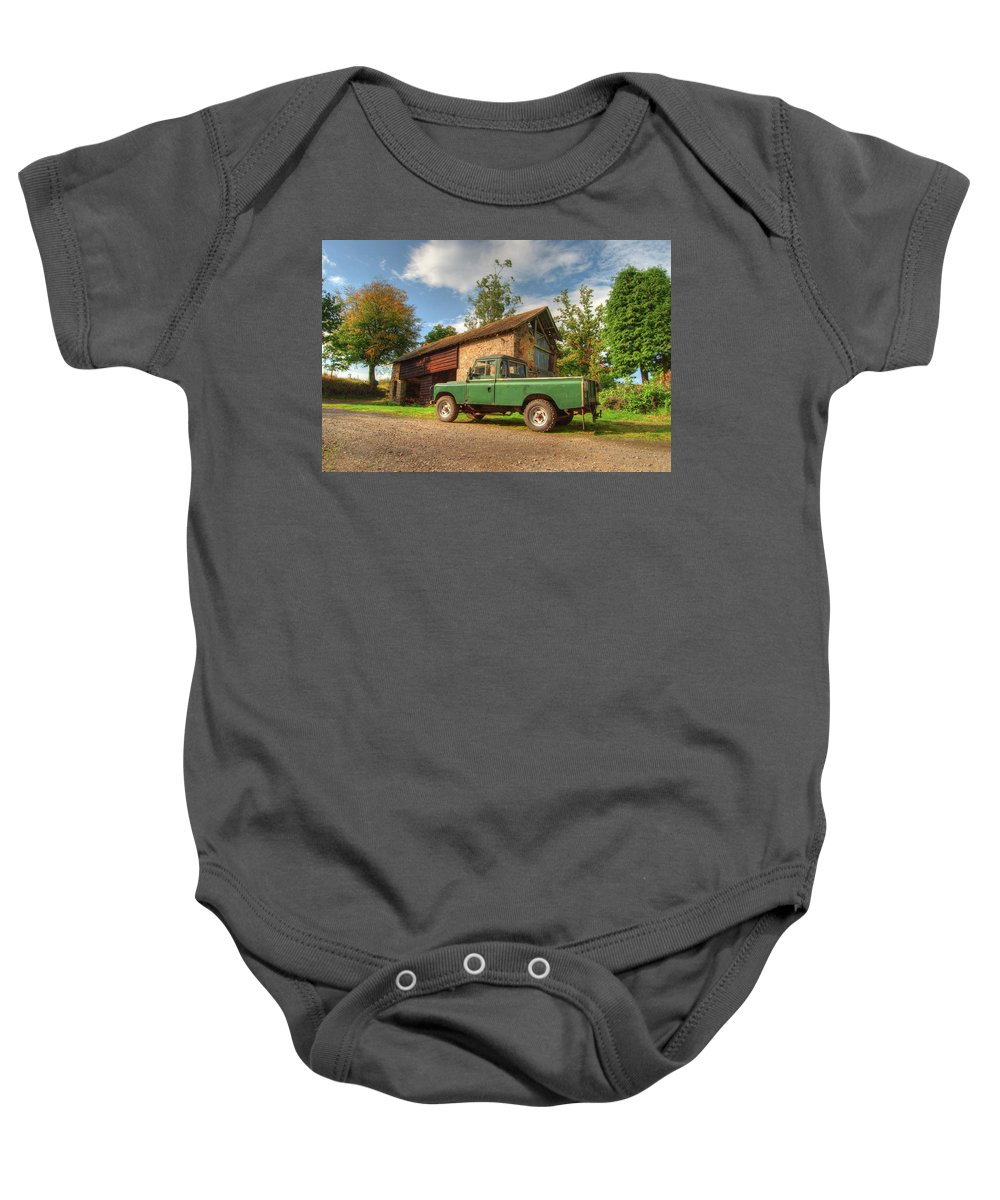Landrover Baby Onesie featuring the photograph Landrover And The Barn by Rob Hawkins