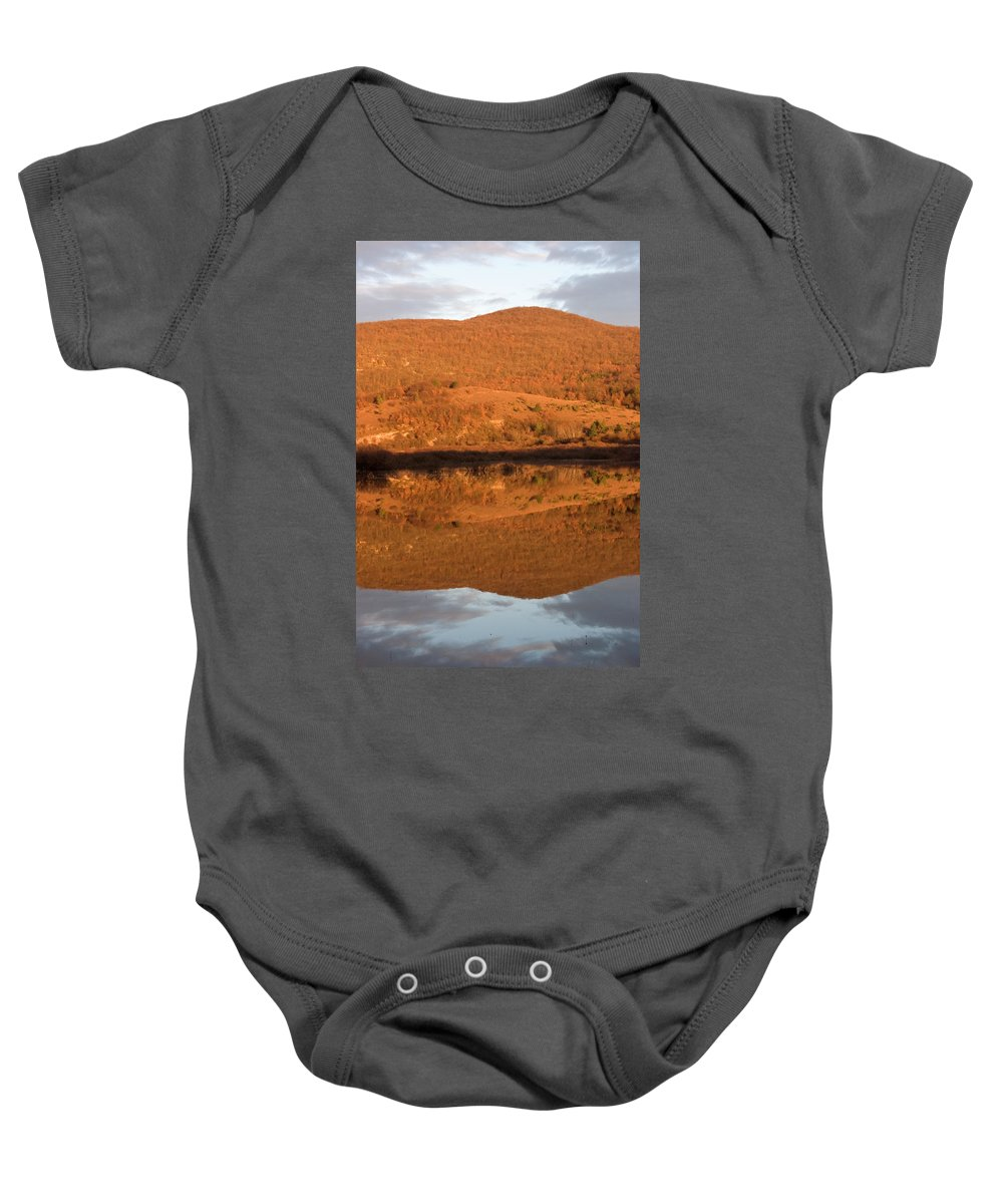Travel Baby Onesie featuring the photograph Landscape Perfectly Reflected In Palsko Lake by Ian Middleton