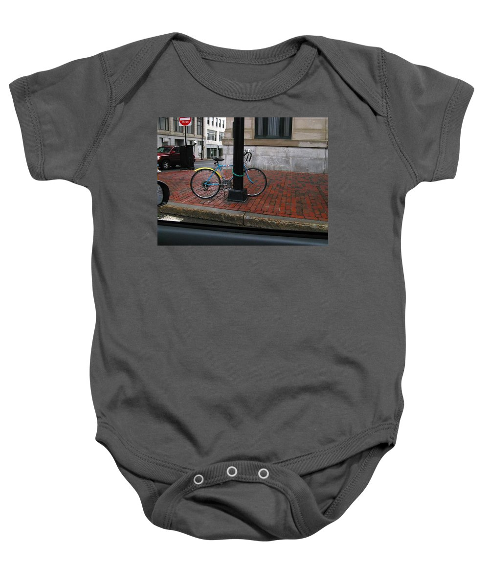 Rainy Baby Onesie featuring the photograph Locked Up In The City by Bill Tomsa