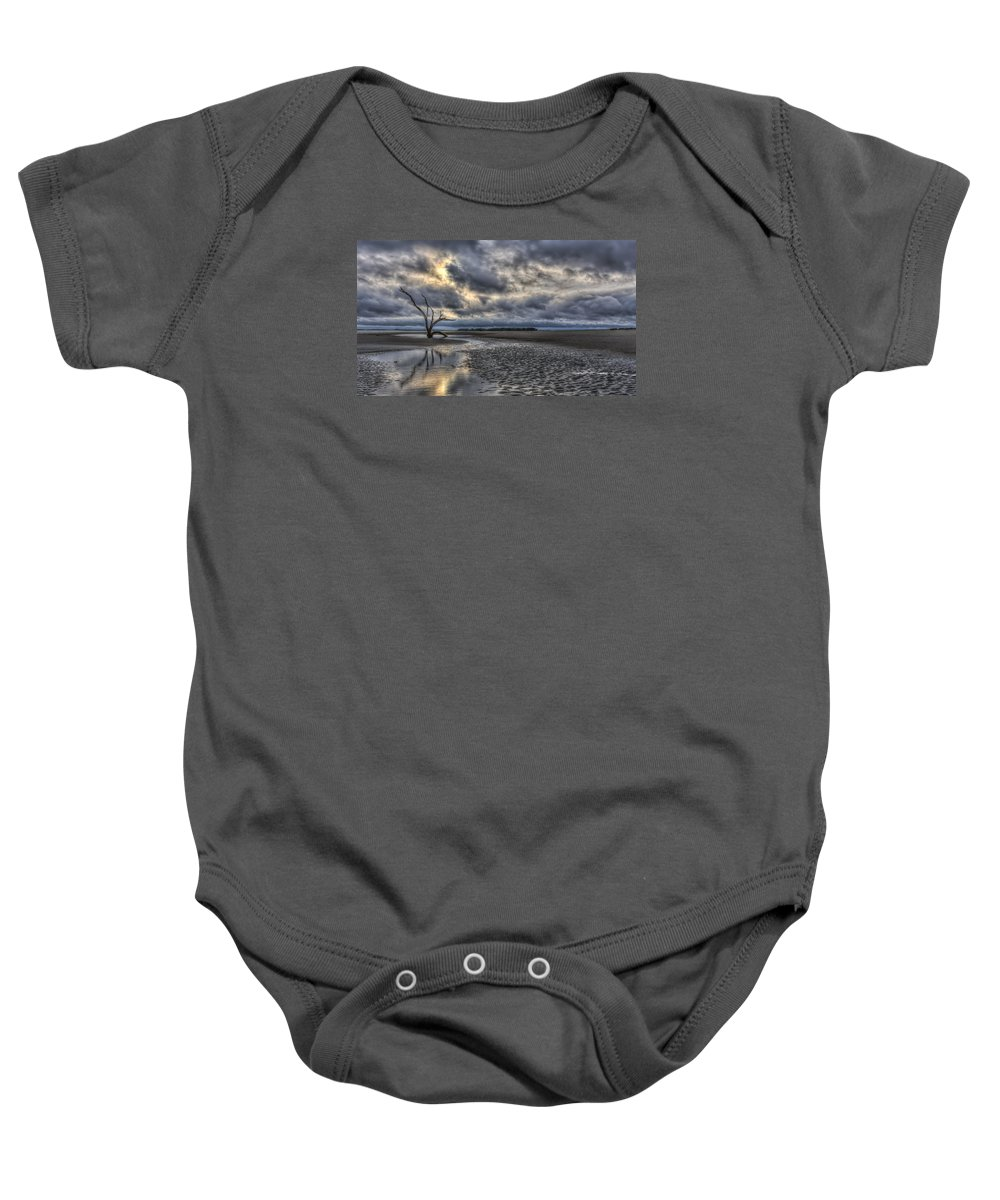 Tree Baby Onesie featuring the photograph Lone Tree Under Moody Skies by Harry B Brown