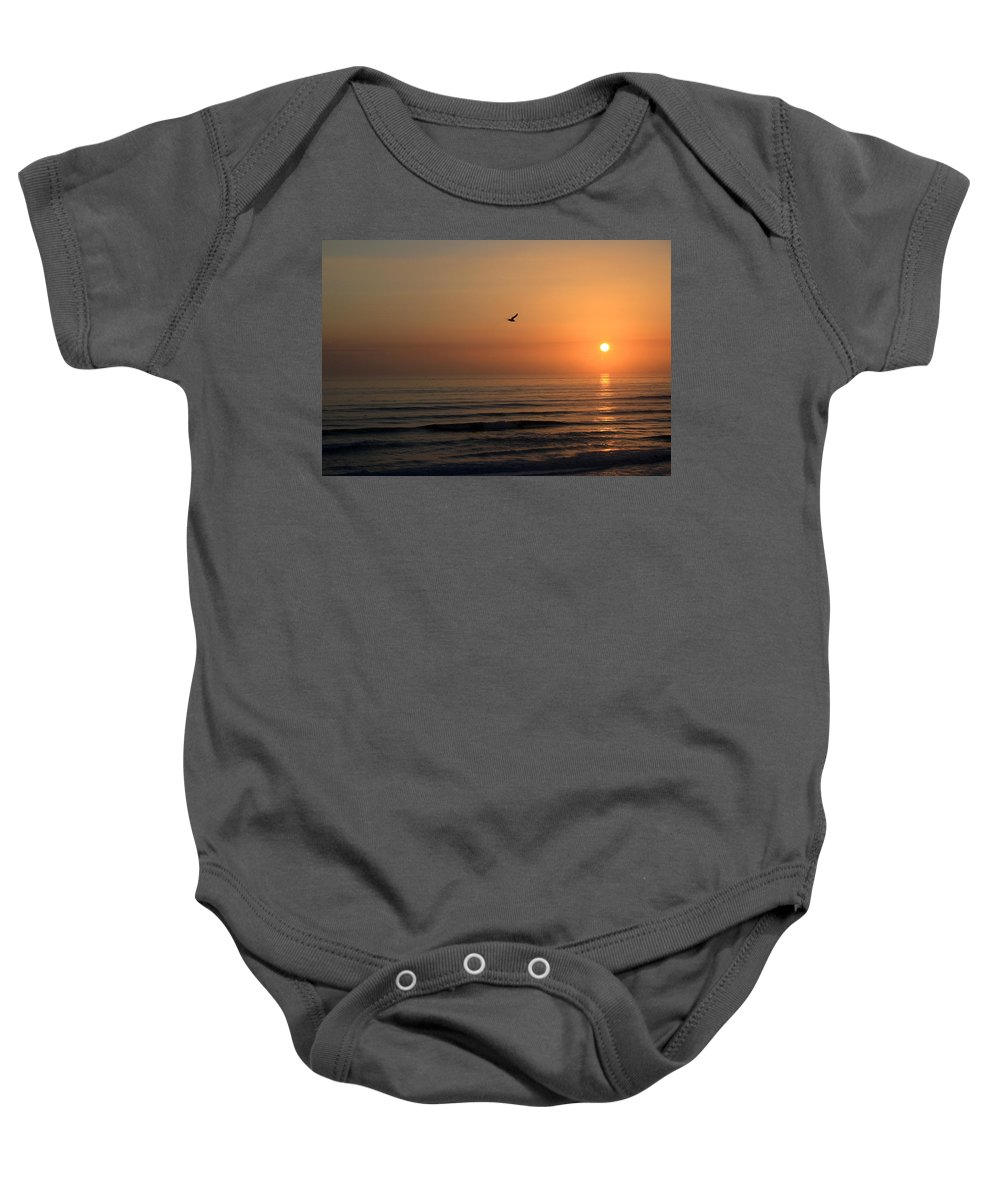Bird Fly Flight Gull Alone Sun Sunrise Sky Ocean Wave Reflection Nature Golden Gold Baby Onesie featuring the photograph Lonely Flight by Andrei Shliakhau