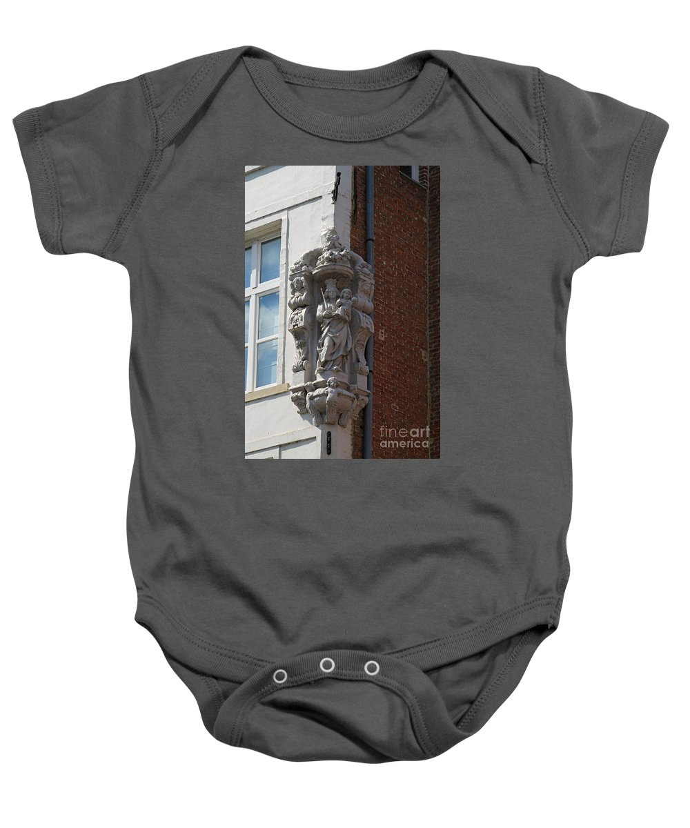 Madonna Baby Onesie featuring the photograph Madonna And Child Statue On The Corner Of A House In Bruges by Louise Heusinkveld