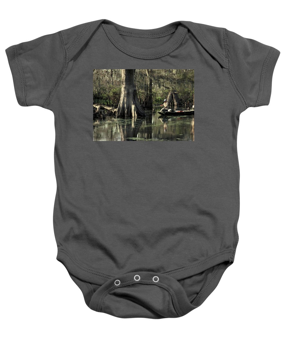 Fishing Baby Onesie featuring the photograph Man Fishing In Cypress Swamp by Herman Robert