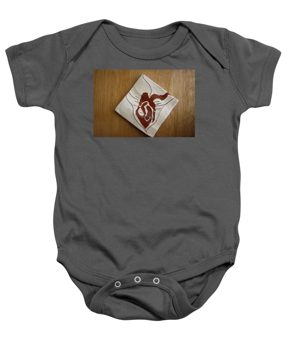 Jesus Baby Onesie featuring the ceramic art Masks - Tile by Gloria Ssali