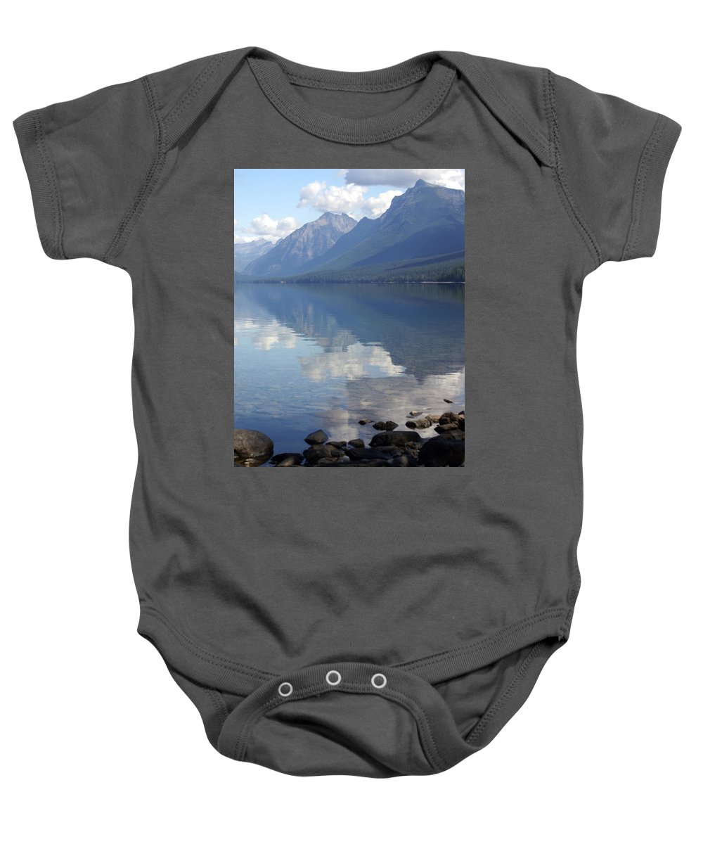 Lake Mcdonald Baby Onesie featuring the photograph Mcdonald Reflection by Marty Koch