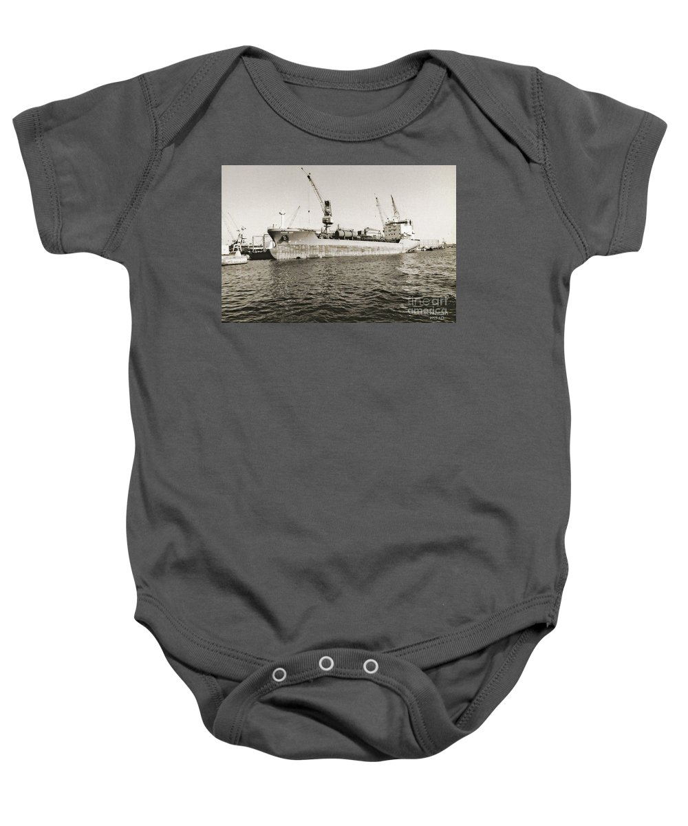 Merchant Ship Baby Onesie featuring the photograph Merchant Ship Docked At Barcelona's Harbour by Don Pedro DE GRACIA