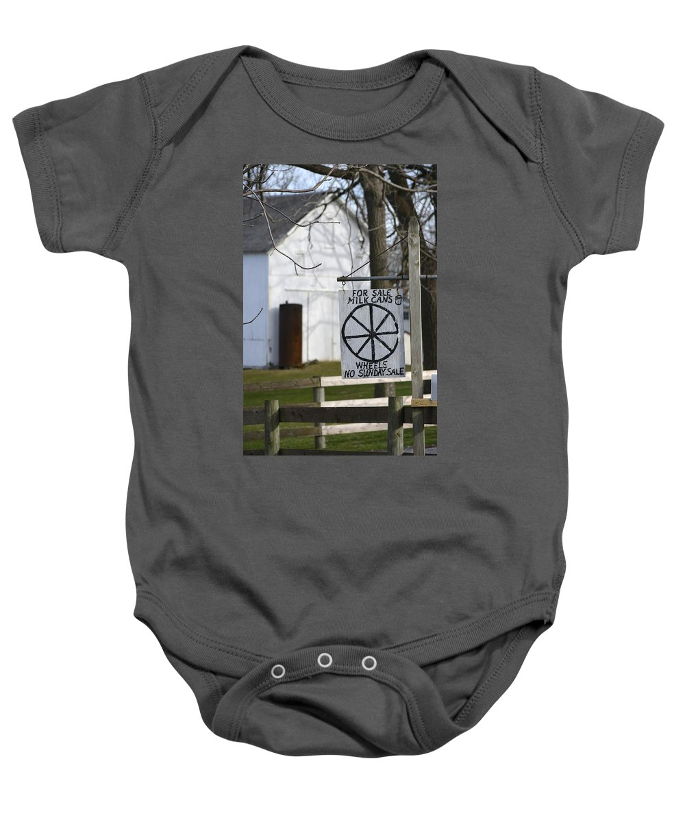 Amish Baby Onesie featuring the photograph Milk Cans And Buggy Wheels by Tana Reiff