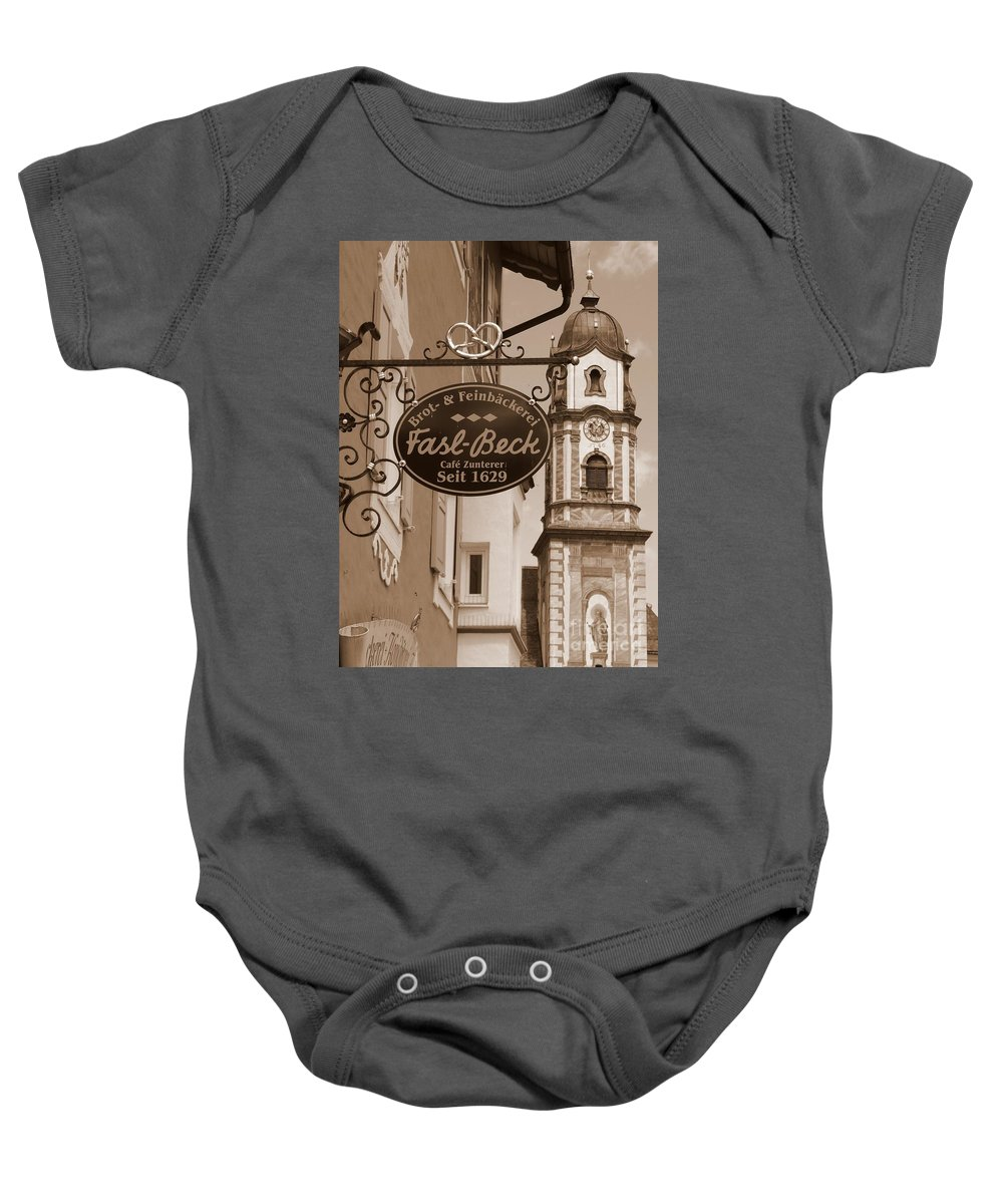 Mittenwald Baby Onesie featuring the photograph Mittenwald Cafe Sign In Sepia by Carol Groenen