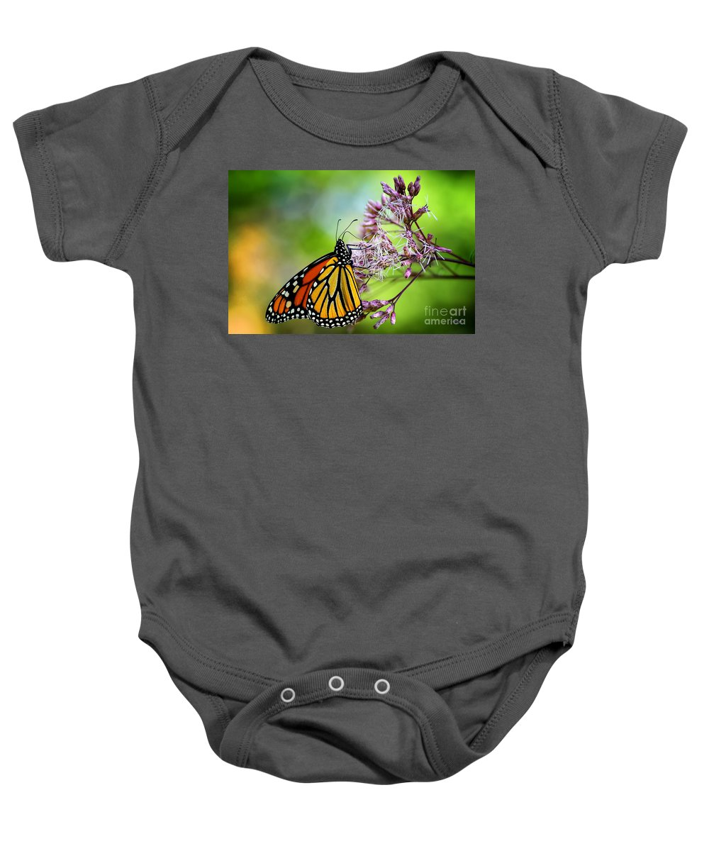 Monarch Baby Onesie featuring the photograph Monarch by Lois Bryan