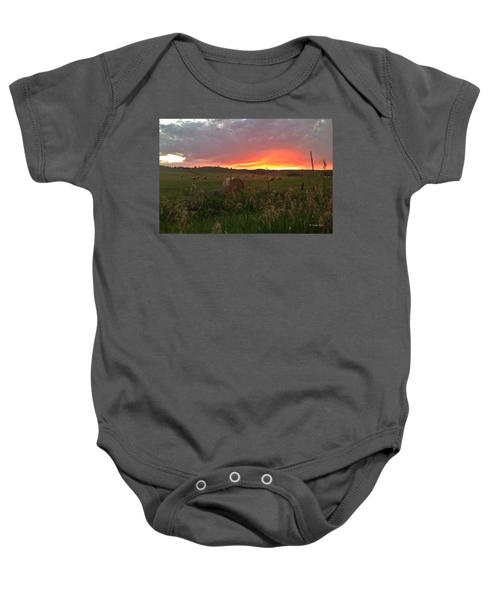 Montana Baby Onesie featuring the photograph Montana Hayfield Sunset by Cindy Rose
