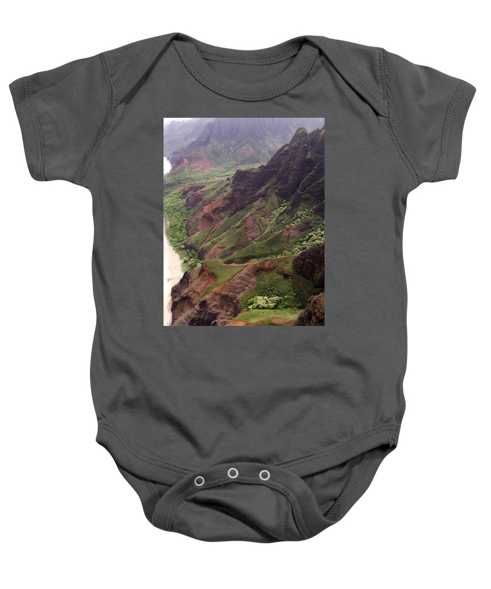 Na Pali Baby Onesie featuring the photograph Na Pali Coast by Amy Fose