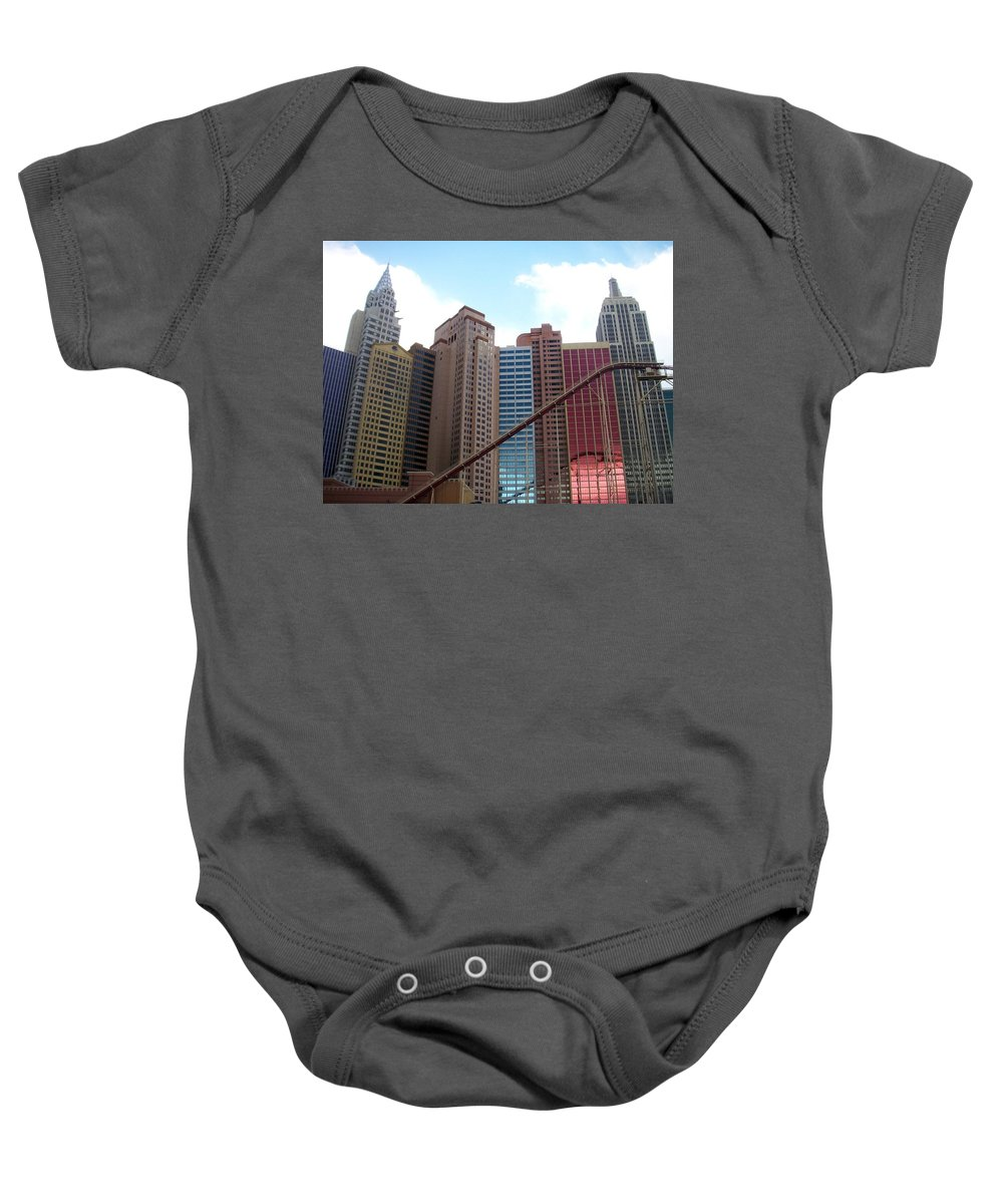 Vegas Baby Onesie featuring the photograph New York Hotel With Clouds by Anita Burgermeister