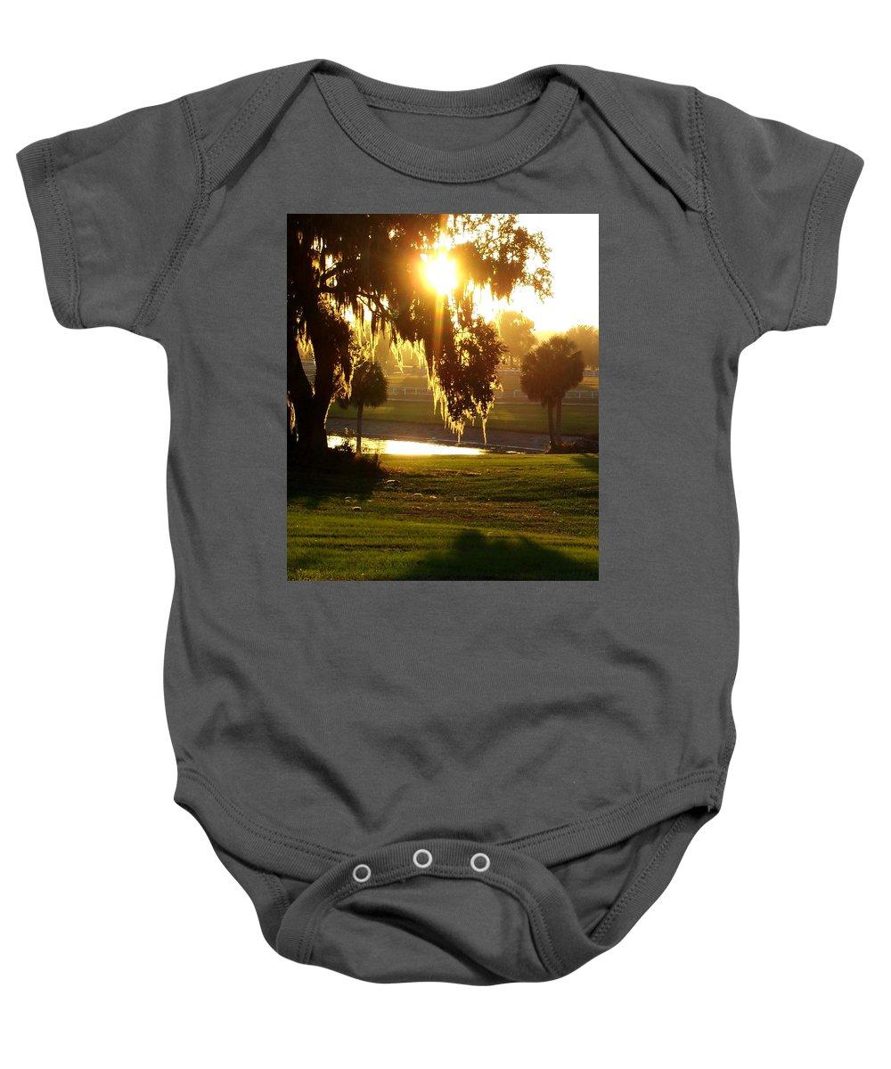 Sunset Baby Onesie featuring the photograph Ocala Sunset by Kristen Wesch