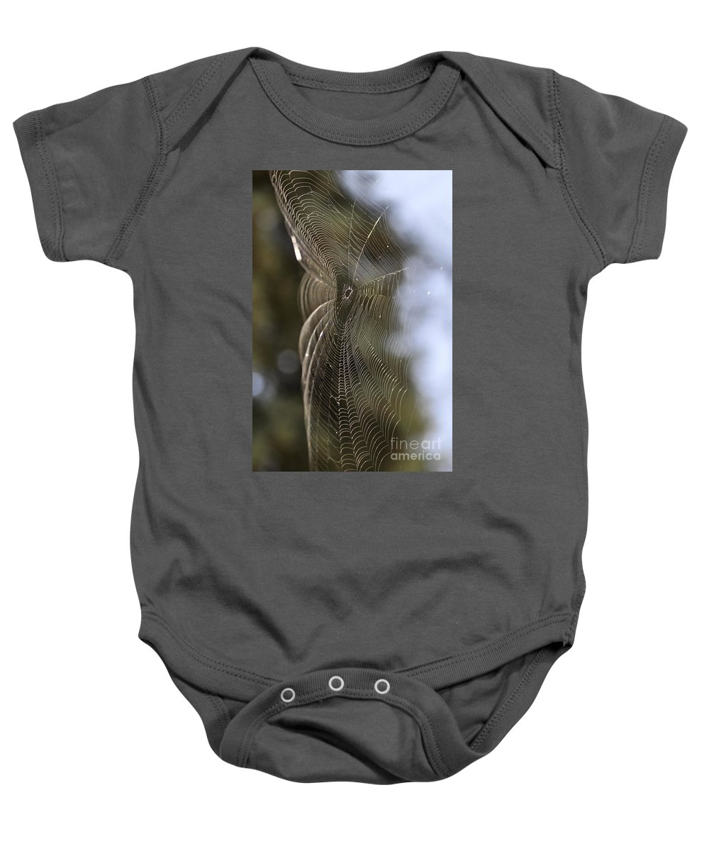 Clay Baby Onesie featuring the photograph Oh What Webs We Weave by Clayton Bruster