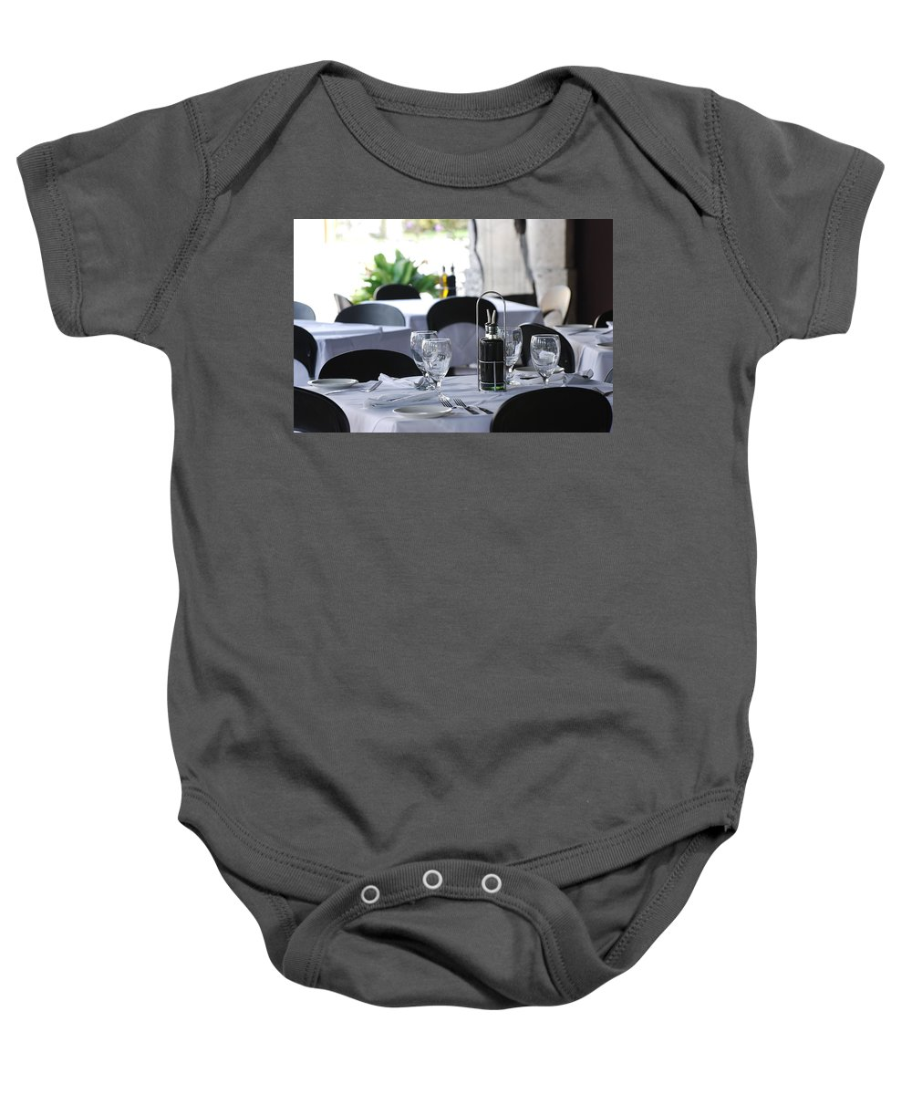 Tables Baby Onesie featuring the photograph Oils And Glass At Dinner by Rob Hans
