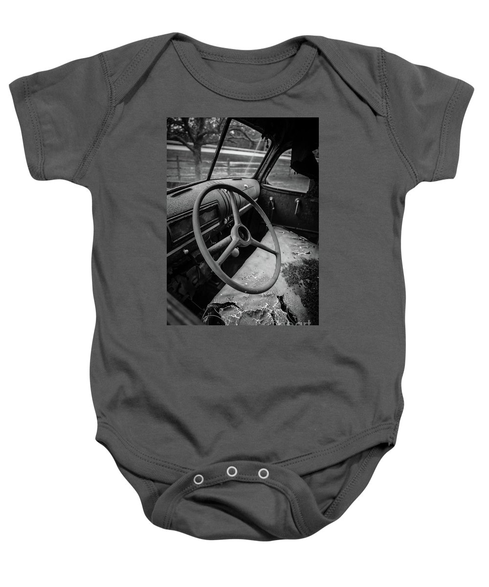Steering Baby Onesie featuring the photograph Old Abandoned Truck Interior by Edward Fielding