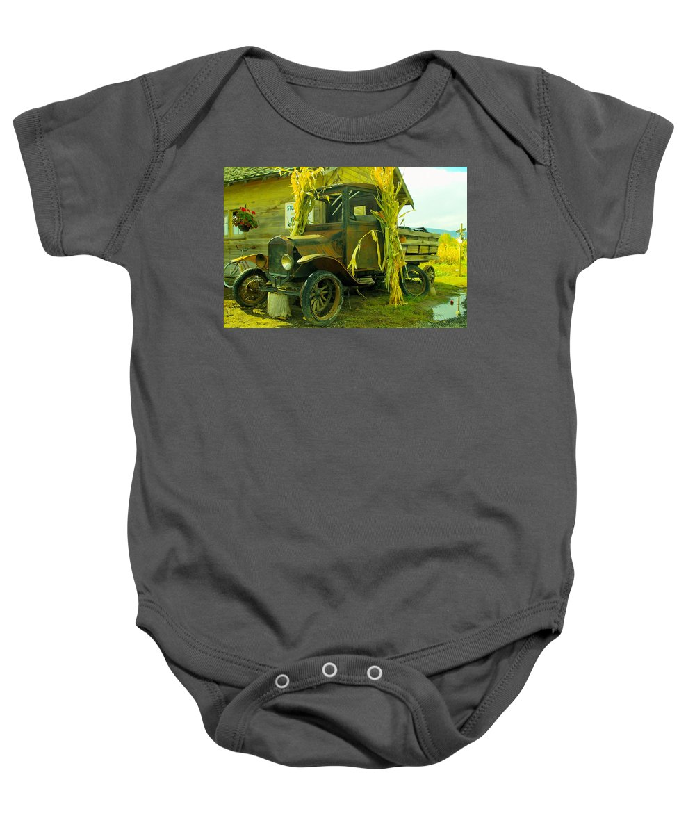 Antigues Baby Onesie featuring the photograph Old Model T by Jeff Swan
