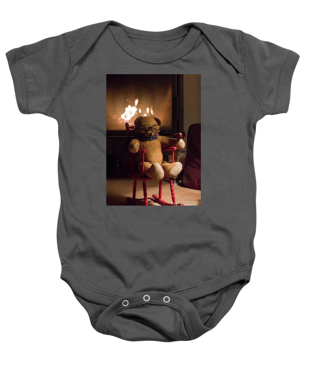 Teddy Baby Onesie featuring the photograph Old Teddy Bear Sitting Front Of The Fireplace In A Cold Night by Andrea Varga