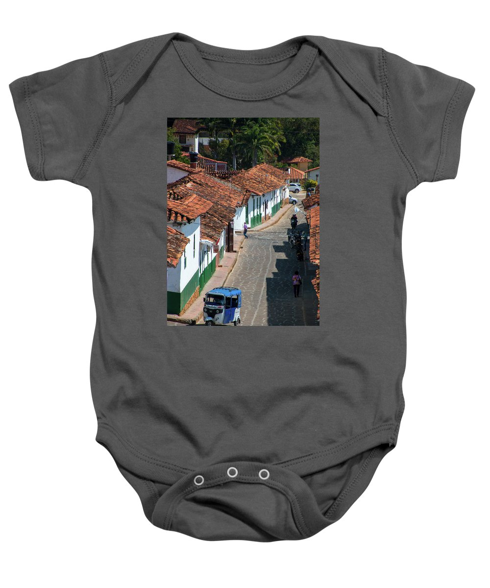 Barichara Baby Onesie featuring the photograph On The Streets Of Barichara - 3 by Riccardo Forte