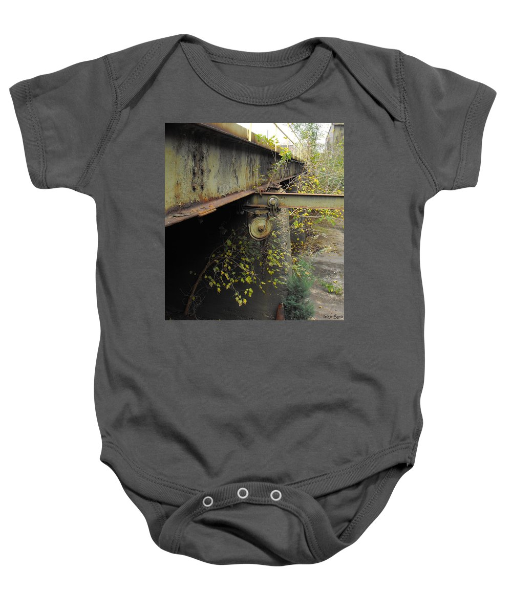 Patina Pulley Baby Onesie featuring the photograph Patina Pulley by Ginger Repke