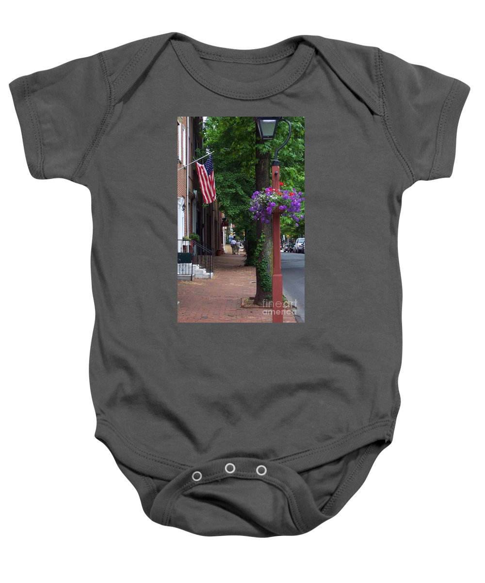 Cityscape Baby Onesie featuring the photograph Patriotic Street In Philadelphia by Debbi Granruth