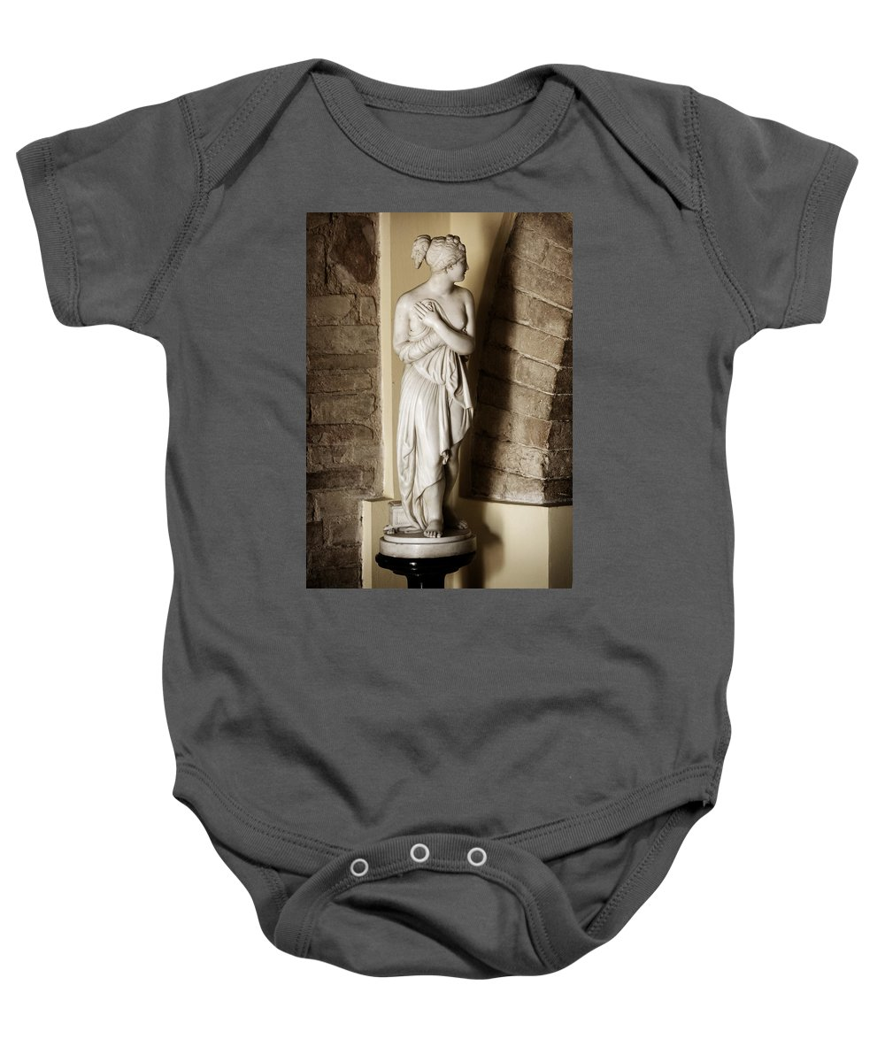 Statue Baby Onesie featuring the photograph Peering Woman by Marilyn Hunt