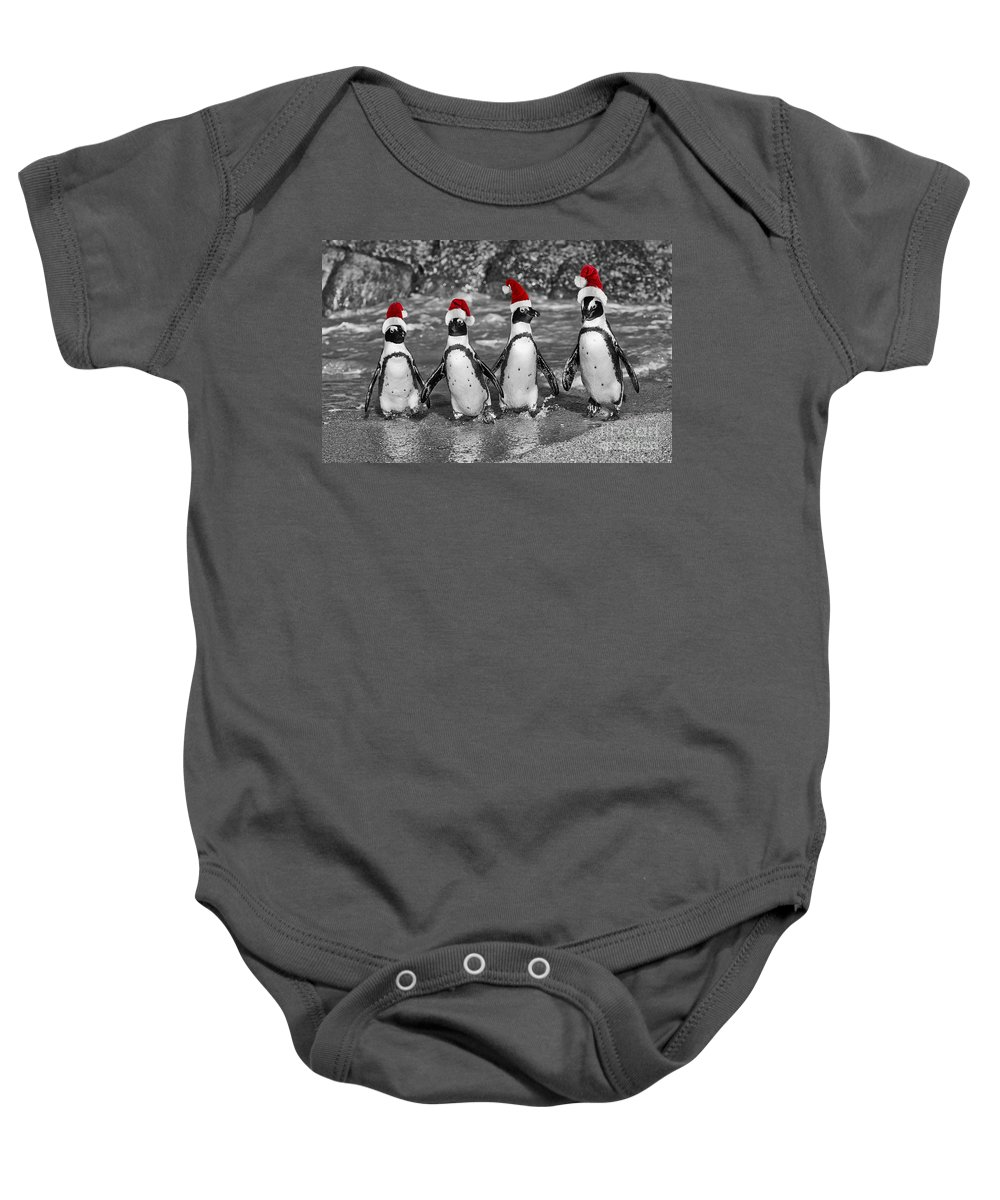 Penguins Baby Onesie featuring the photograph Penguins With Santa Claus Caps by Juergen Ritterbach
