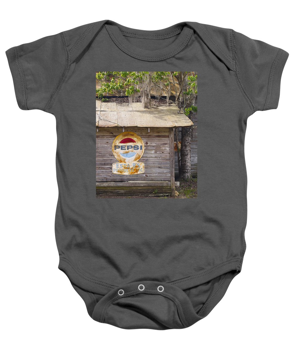 Fl Baby Onesie featuring the photograph Pepsi Sign by Bill Chambers