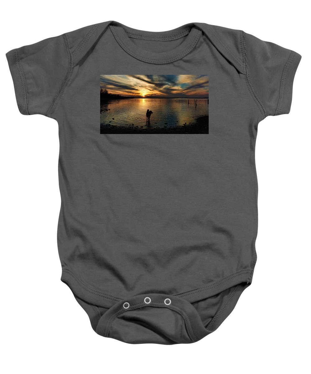 Sunset Baby Onesie featuring the photograph Poised For Action by Carolyn Fletcher