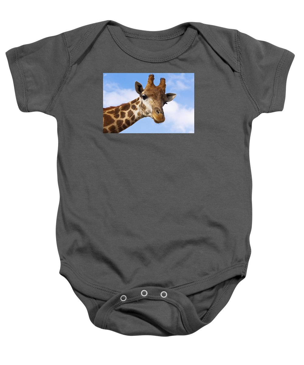 Outdoor Baby Onesie featuring the photograph Portrait Of A Giraffe On The Background Of Blue Sky. by Olga Goncharenko