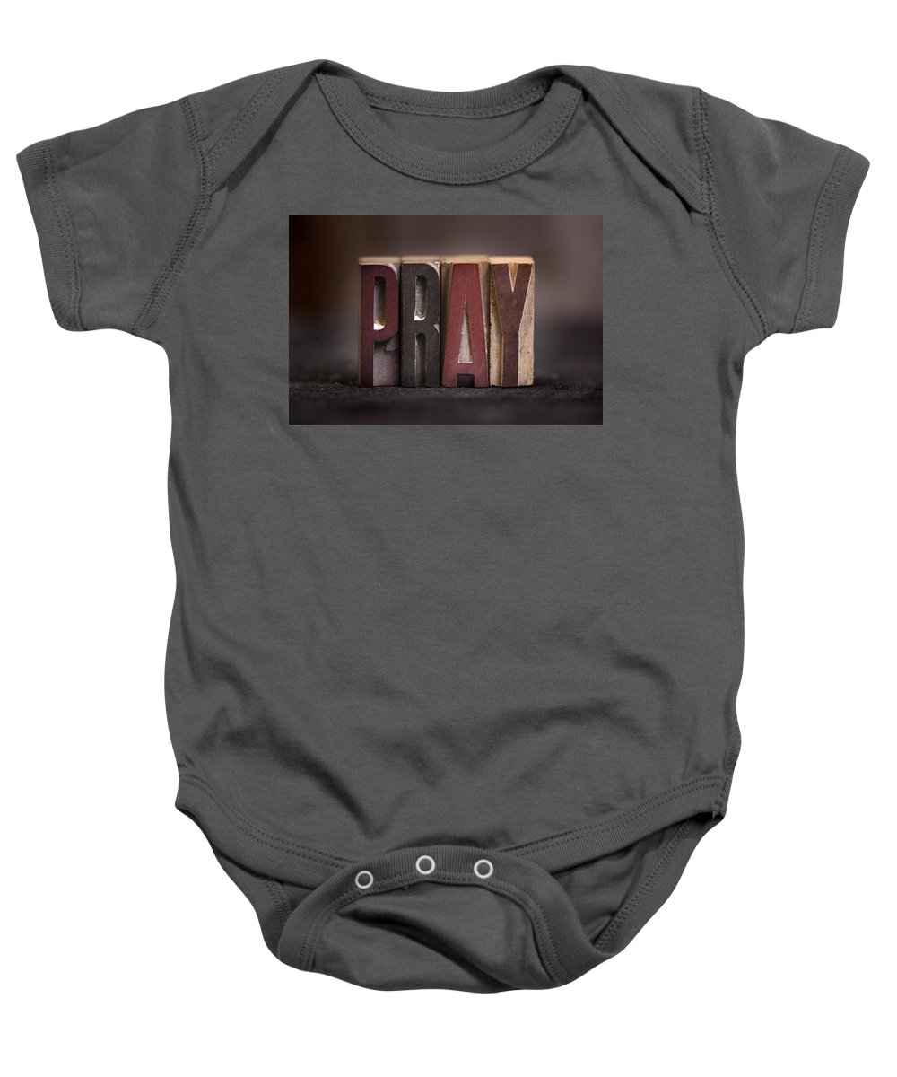Pray Baby Onesie featuring the photograph Pray - Antique Letterpress Letters by Donald Erickson
