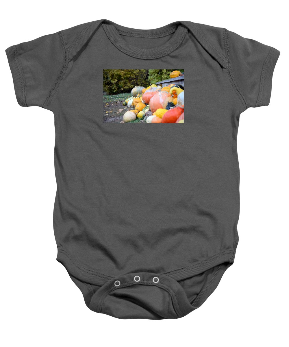 Pumpkins Baby Onesie featuring the photograph Pumpkins by Camelia C