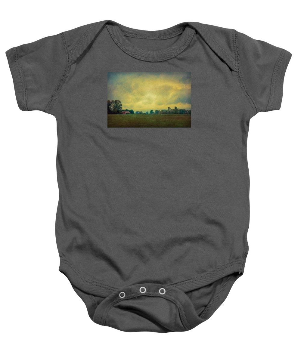 Barn Baby Onesie featuring the photograph Red Barn Under Stormy Skies by Don Schwartz