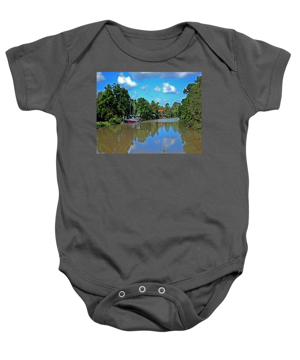Sailboat Baby Onesie featuring the painting Red Boat And The Magnolia River by Michael Thomas