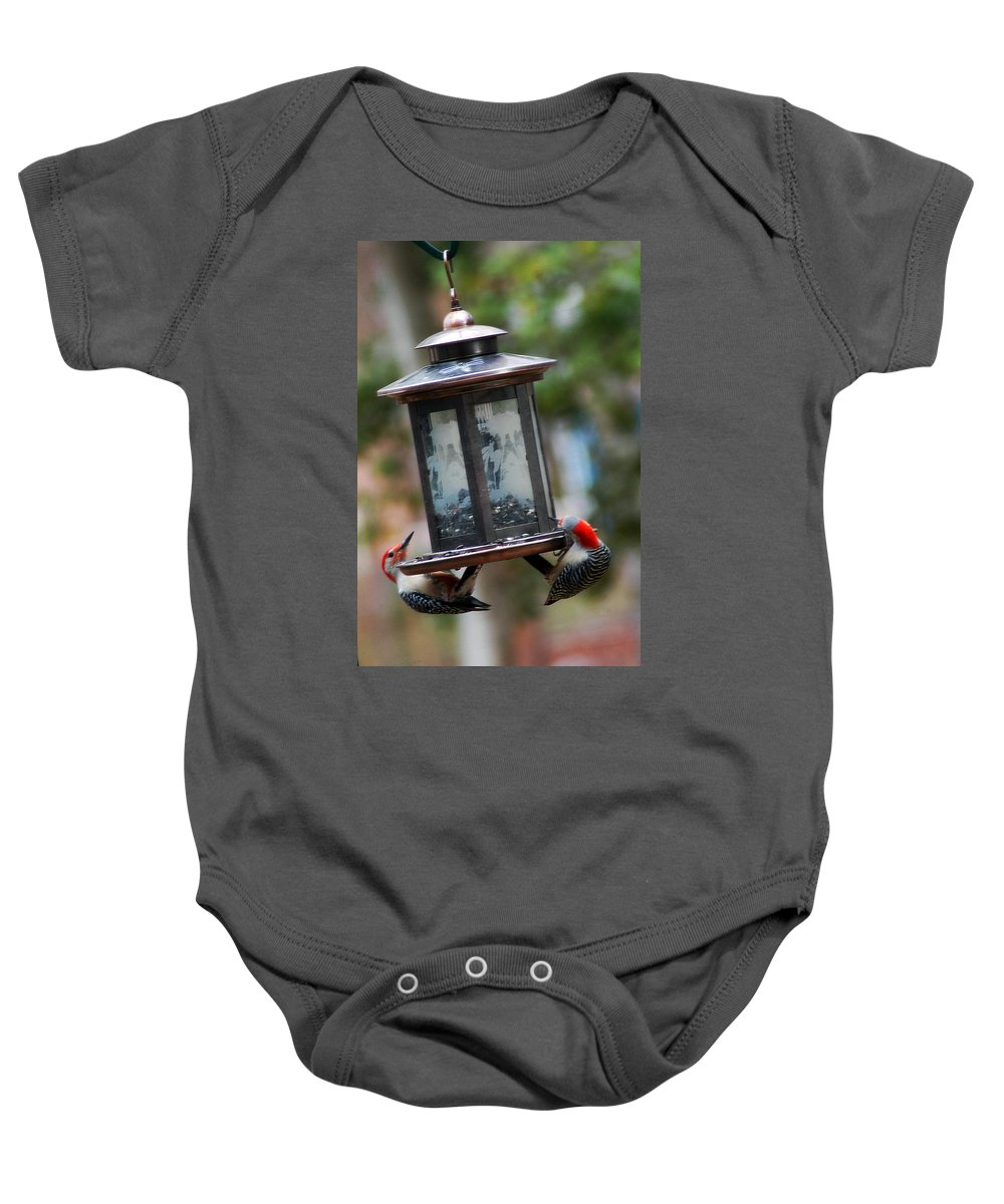 Clay Baby Onesie featuring the photograph Red Head Wood Peckers On Feeder by Clayton Bruster