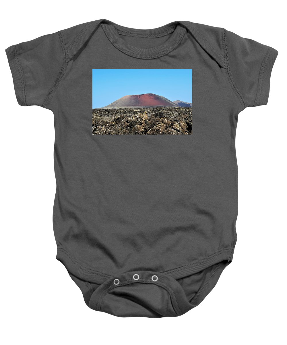 Volcano Lava Ash Sky Blue Red Rocks Stone Landscape Lanzarote Canary Island Spain Travel Holiday Vacation Baby Onesie featuring the photograph Red Volcano by Piotr Pieszak
