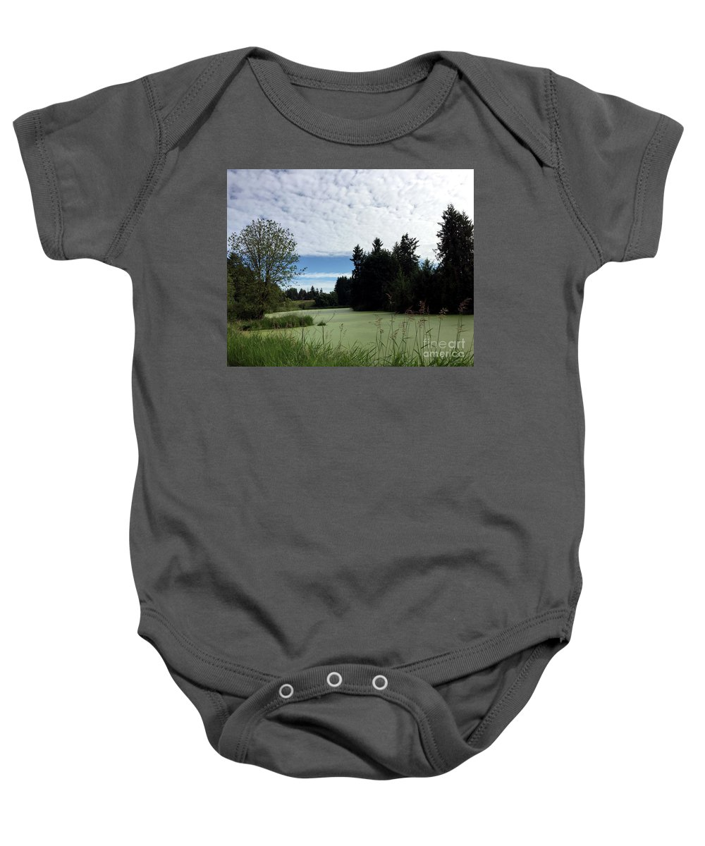 Sky Baby Onesie featuring the photograph River Of Algae And Stippled Clouds by Paula Joy Welter