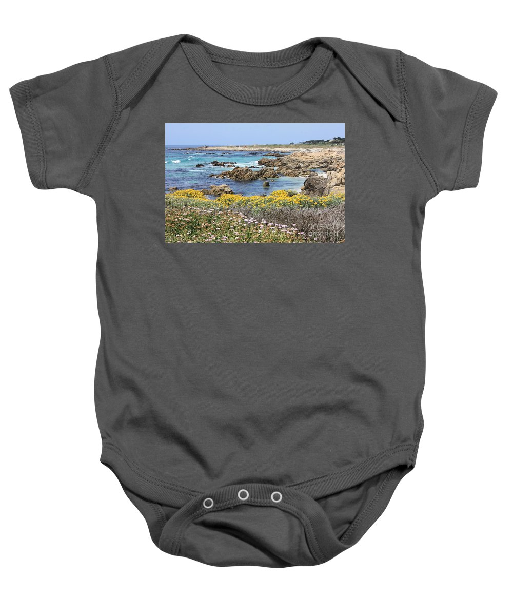 Ocean Baby Onesie featuring the photograph Rocky Surf With Wildflowers by Carol Groenen