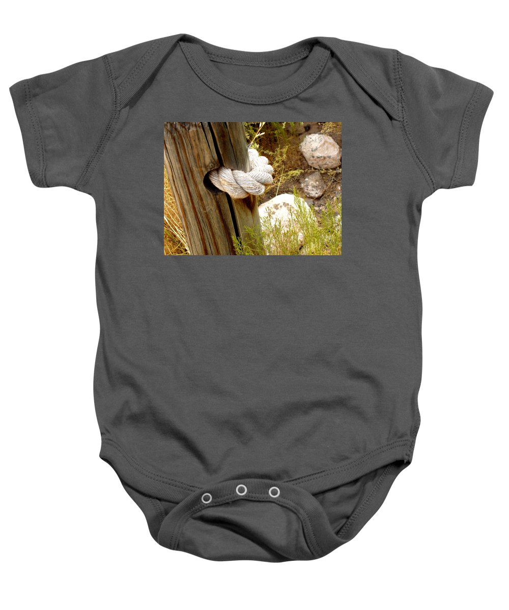 Rope Baby Onesie featuring the photograph Rope In A Post by Wayne Potrafka