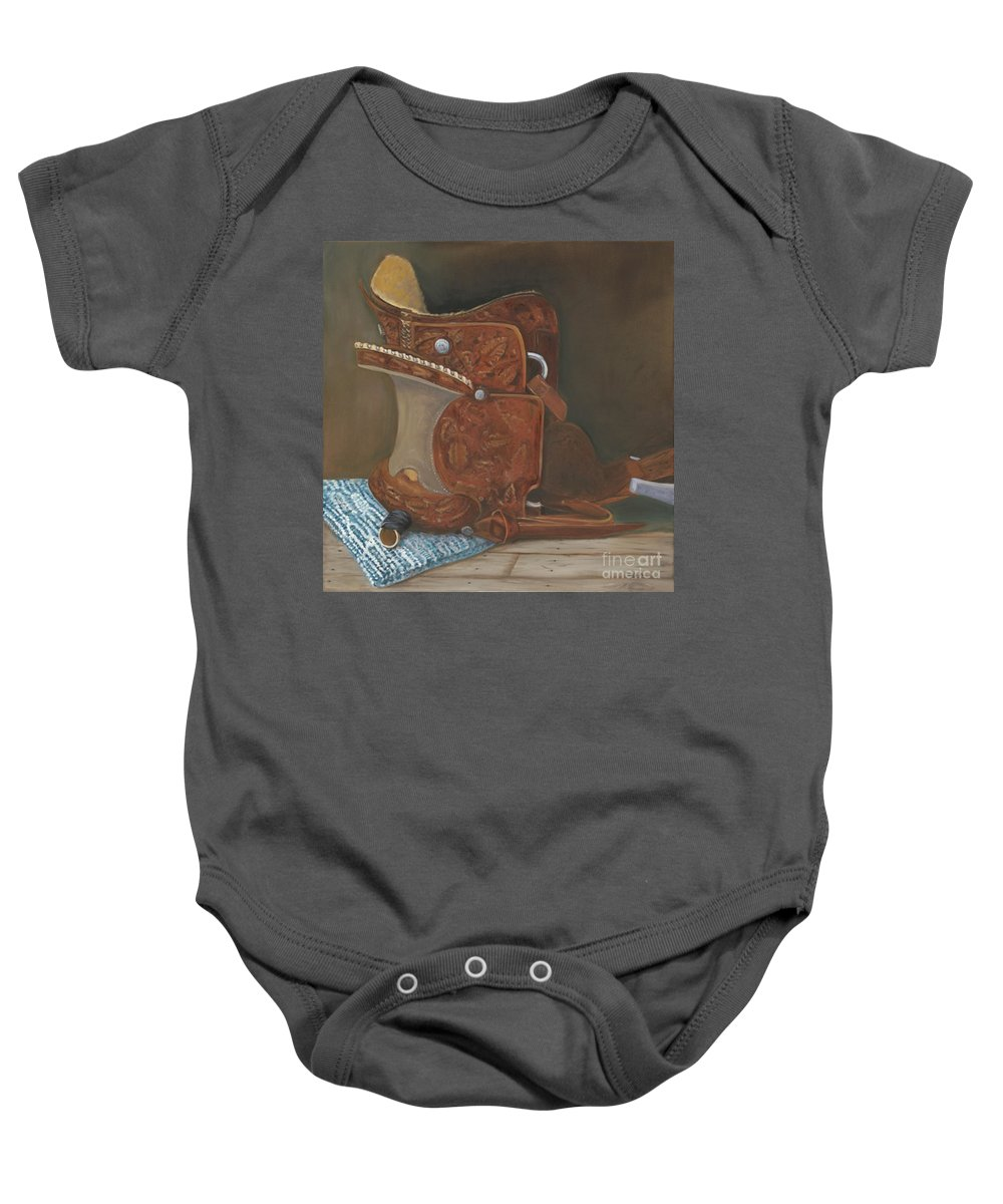 Saddle Baby Onesie featuring the painting Roping Saddle by Mendy Pedersen