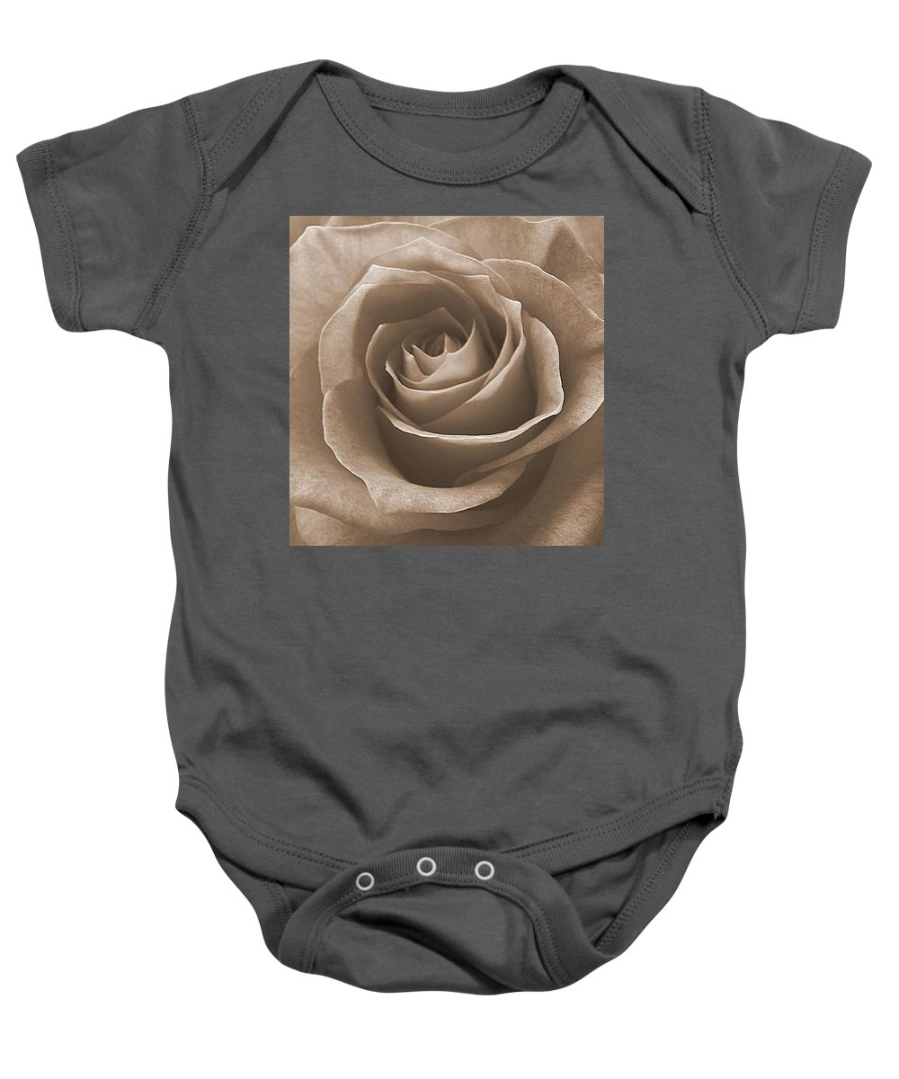 Rose Sepia Pedals Baby Onesie featuring the photograph Rose In Sepia by Luciana Seymour