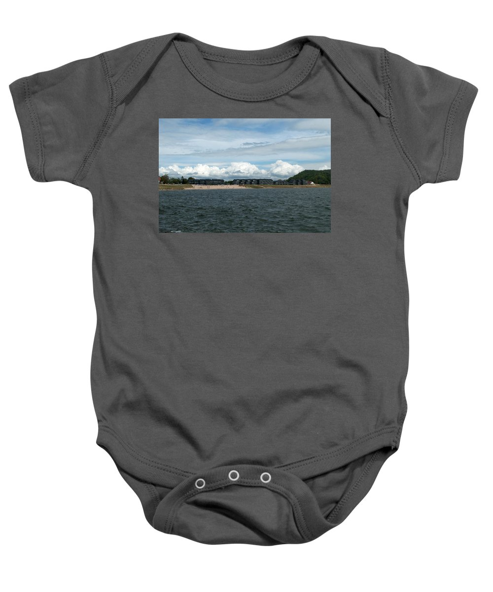Michigan Baby Onesie featuring the photograph Row Of Clouds by Linda Kerkau