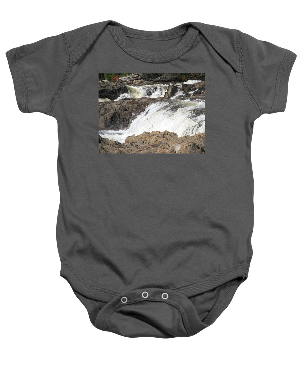 Waterfall Baby Onesie featuring the photograph Rushing by Kelly Mezzapelle