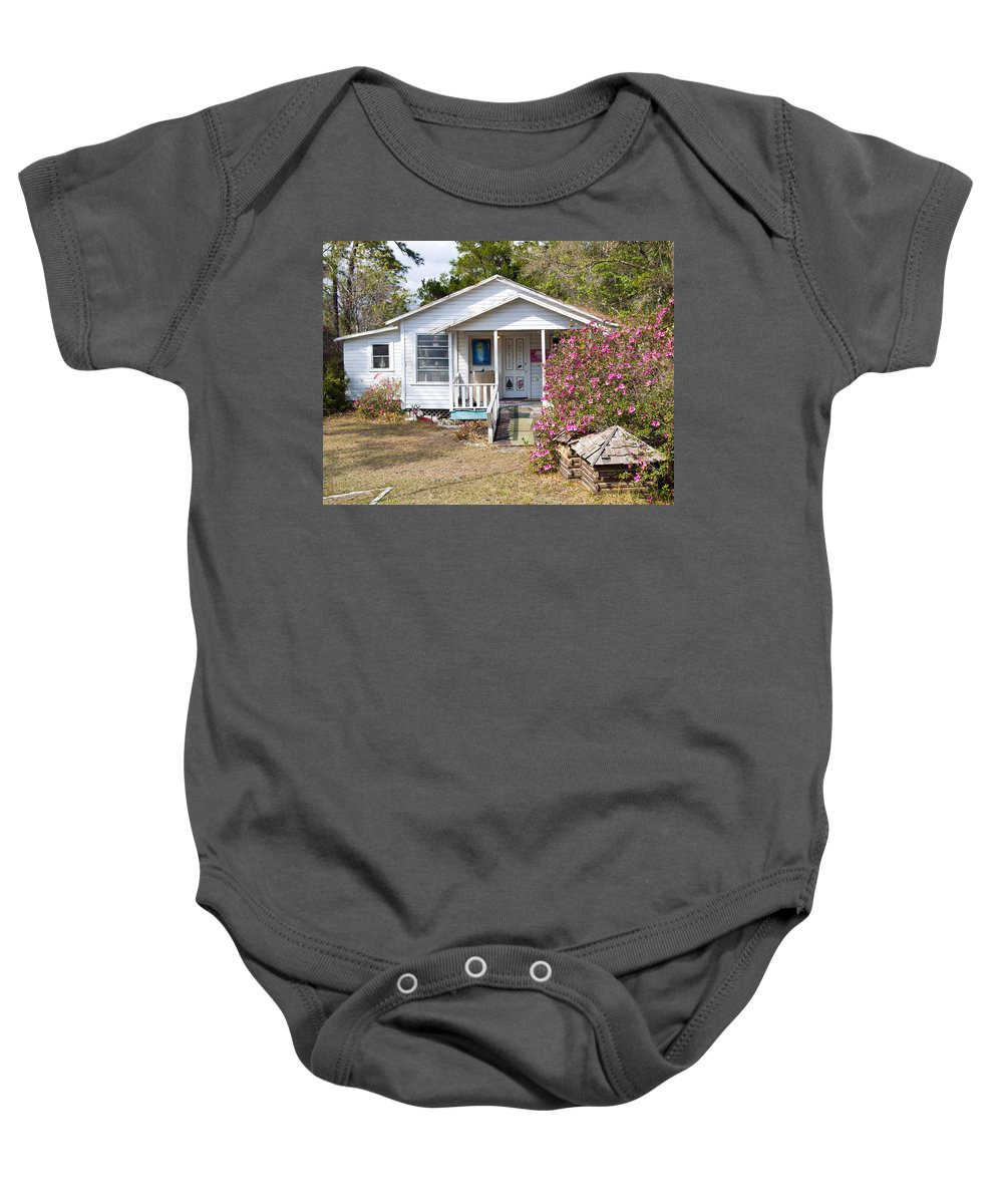 Cabin Baby Onesie featuring the photograph Santa And Mrs Claus Spend The Spring Months Relaxing by Allan Hughes