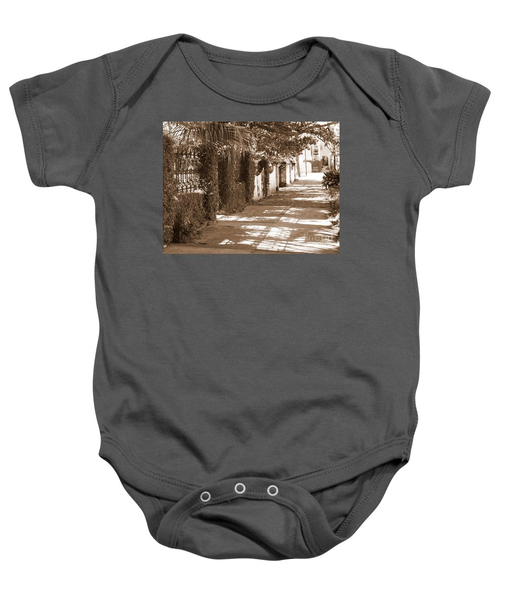 Savannah Baby Onesie featuring the photograph Savannah Sepia - Sunny Sidewalk by Carol Groenen