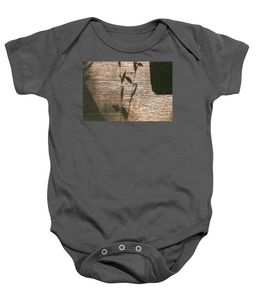 Clay Baby Onesie featuring the photograph Shadows Of Life by Clayton Bruster